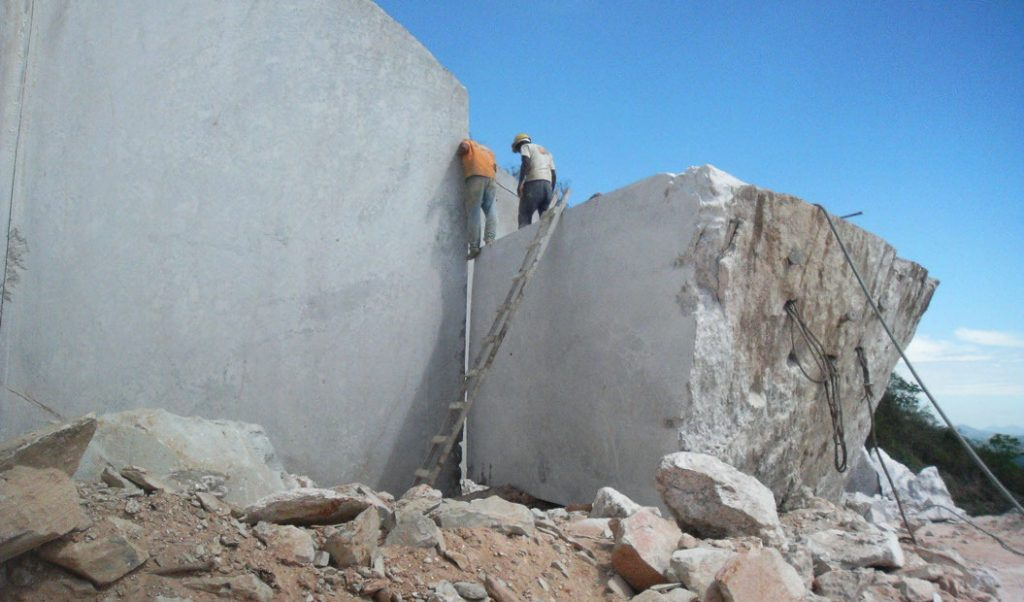people working in rock quarry