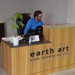 man at front desk at earth art