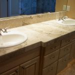 beige bathroom counter with two sinks