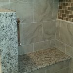 brown speckled granite shower