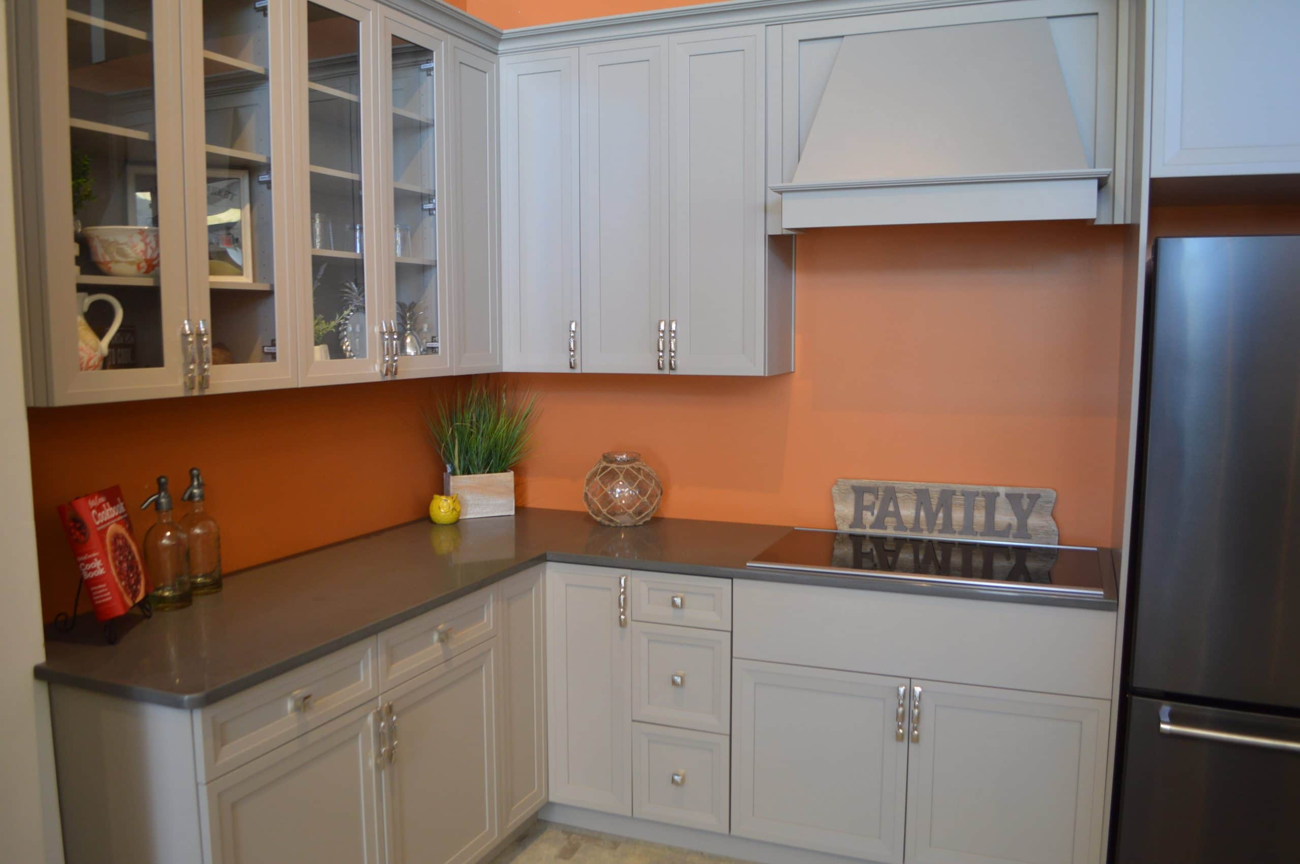 beige cabinets and orange walls