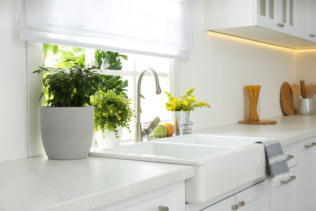 Beautiful white sink near window in modern kitchen